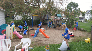 volunteers cleaning up Ruth's House backyard